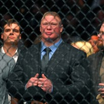 Former UFC heavyweight champion Brock Lesnar watches Ronda Rousey and Cat Zingano as they get ready to fight in a UFC 184 mixed martial arts bantamweight title bout, Saturday, Feb. 28, 2015, in Los Angeles. Rousey won after Zingano tapped out 14 seconds into the first round. (AP Photo/Mark J. Terrill)  ORG XMIT: LAS142