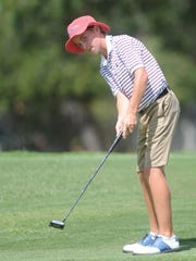 Abilene's Karson Grigsby, 13, putts at hole No. 5 during