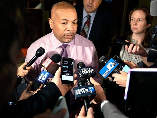 Assembly Speaker Carl Heastie, D-Bronx, speaks to reporters