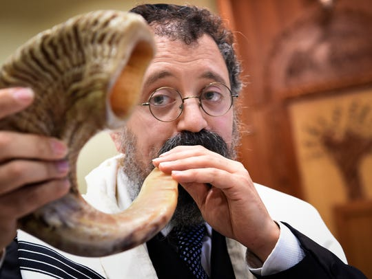 Rabbi Yitzchok Tiechtel practices blowing the shofar at the Chabad Center in Nashville in 2017.