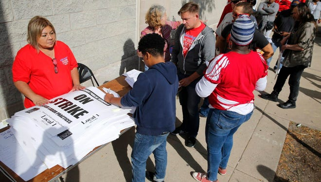 Chicago Teachers Union members pick up strike material outside union's strike headquarters Monday, Oct. 10, 2016, in Chicago. Negotiators for the union and Chicago Public Schools continue to meet in an effort to reach a contract and avert a threatened teachers' strike.