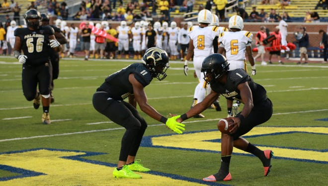 Paramus Catholic WR Donte Small (1) celebrates with teammate Javon Turner (11) after Small scored a third quarter touchdown against St. Frances Academy at Michigan Stadium in September.
