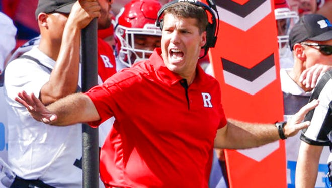 FILE - In this Sept. 23, 2017, file photo, Rutgers head coach Chris Ash calls a timeout during the first half of an NCAA college football game against Nebraska in Lincoln, Neb. Rutgers is surging and Michigan is reeling into a suddenly interesting matchup at the Big House. (AP Photo/Nati Harnik, File)