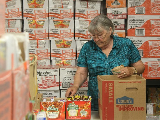 Packs for Hunger organizer Sharon Nell puts snacks