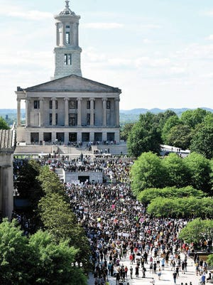 """Protesters gather on Legislative Plaza in Nashville for the """"I Will Breathe"""" rally to protest the death of George Floyd, an unarmed black man who died after being pinned down by a white Minneapolis police officer on Memorial Day."""