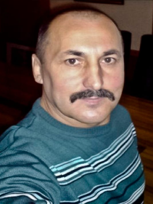 """This undated photo provided by the Moldova General Police Inspectorate shows Alexandr Agheenco, a Russian citizen based in Moldova's breakaway region of Trans-Dniestr, and called """"the Colonel"""" by his cohorts. Authorities said a 2011 uranium-235 smuggling operation was led by him with Teodor Chetrus, a former KGB informant, as his middleman."""