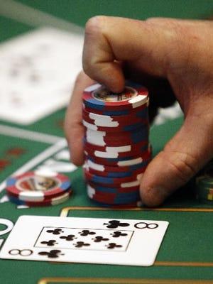 A dealer handles chips at Sands Casino Resort Bethlehem in Bethlehem, Pa.  Pennsylvania casinos are reporting record revenue totaling more than $3.2 billion last year.