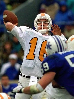 FILE - In this Nov. 22, 1997, file photo, Tennessee quarterback Peyton Manning launches a pass during the second half of his team's 59-31 win over Kentucky in an NCAA college football game in Lexington, Ky. Manning and his Southeastern Conference nemesis, former Florida coach Steve Spurrier, will go into the College Football Hall of Fame together. Manning started for four season at Tennessee and set school records for yards passing (11,201) and touchdown passes (89). (AP Photo/Ed Reinke, File)