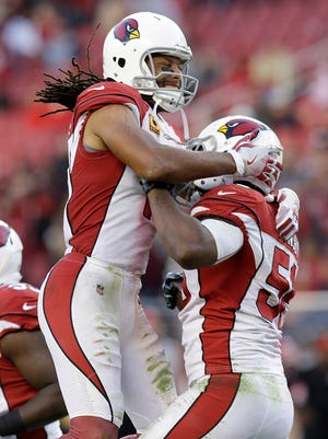 Arizona Cardinals inside linebacker Karlos Dansby, right, celebrates with Larry Fitzgerald after intercepting a pass from San Francisco 49ers quarterback C.J. Beathard during the second half of an NFL football game in Santa Clara, Calif., Sunday, Nov. 5, 2017. (AP Photo/Ben Margot)