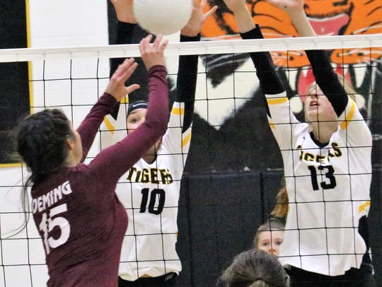 Deming's Joleen Perez attempts to set a ball over Alamogordo's