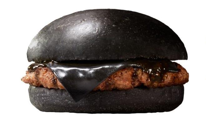 "Burger King Japan unveiled their latest menu editions, the all-black ""Kuro"" burger."
