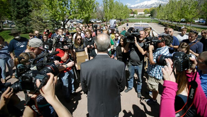 Brent Webb Brigham Young University Academic Vice President speaks with protesters who stand in solidarity with rape victims on the campus of Brigham Young University during a sexual assault awareness demonstration Wednesday, April 20, 2016, in Provo, Utah. BYU students who say they were sexually assaulted are finding themselves under investigation for possible violations of the Mormon school's honor code against sex and drinking. BYU says it will re-evaluate the practice. (AP Photo/Rick Bowmer)