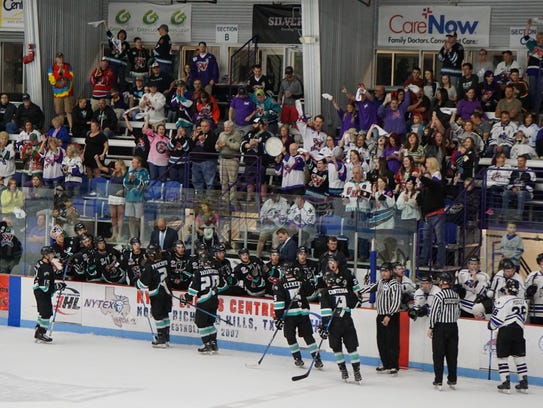 The Shreveport Mudbugs bench and fans celebrate a goal