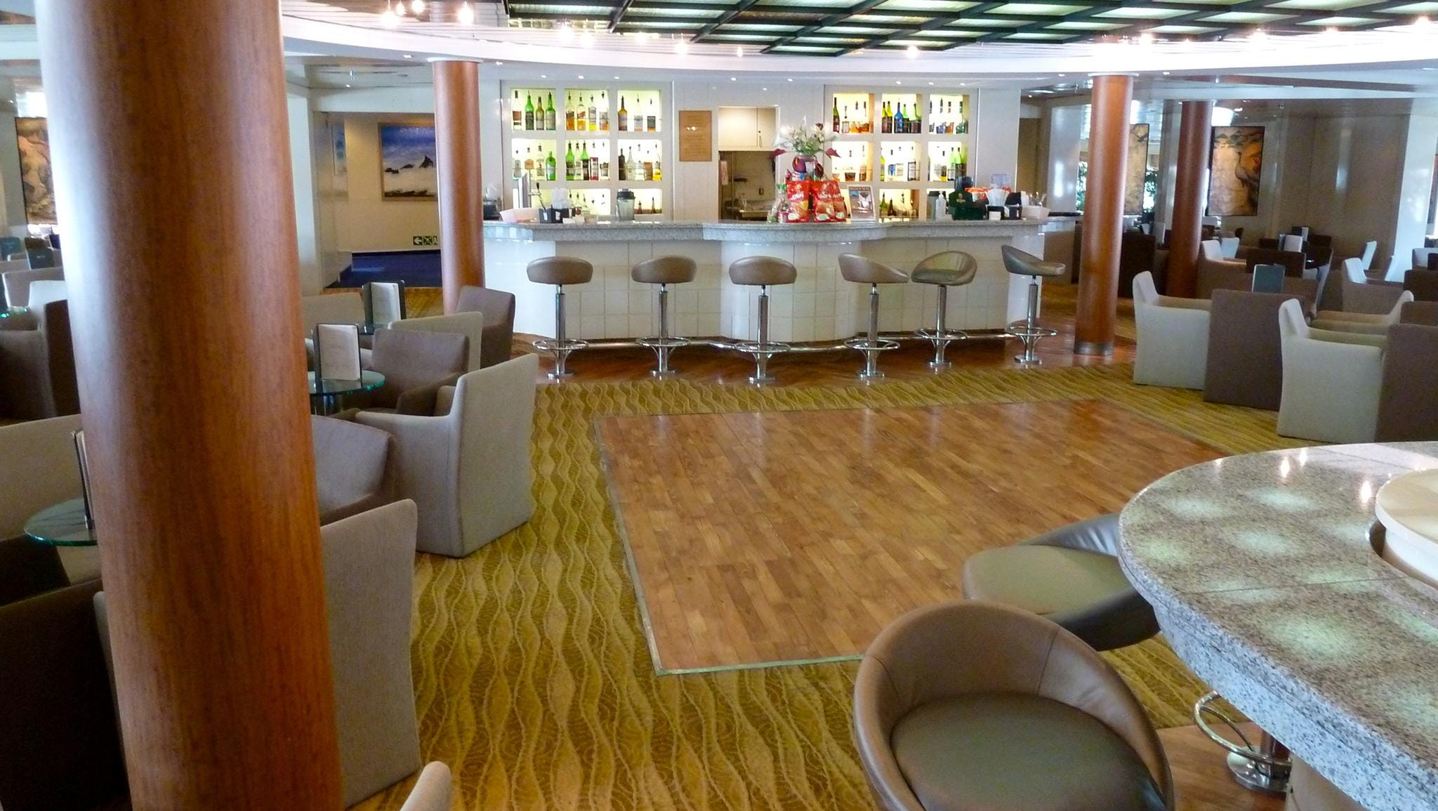 The Captain's Club has a skylight-topped dance floor and extra seating at the bar as well as around the grand piano.