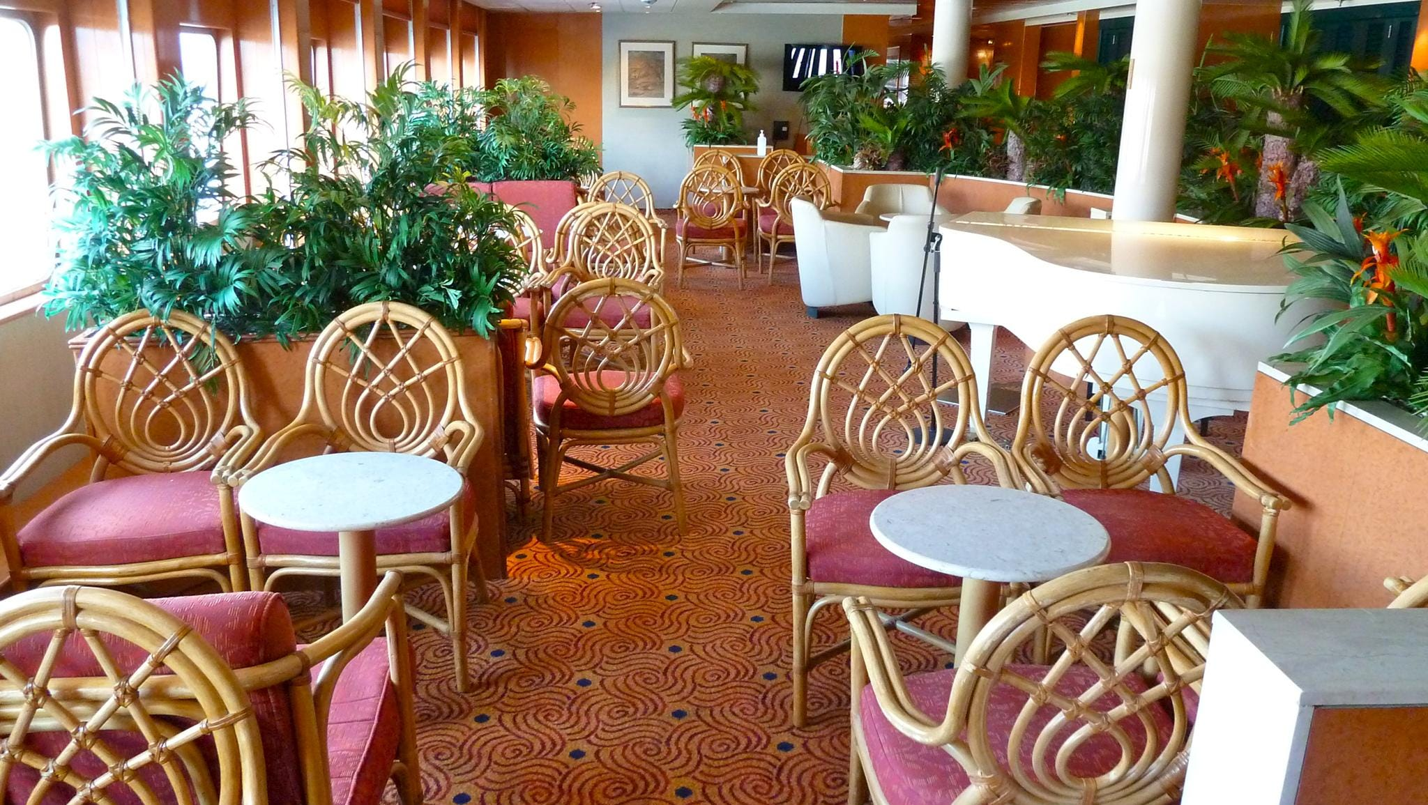 The 40-seat Palm Garden, located on starboard Magellan Deck, is a perfect spot for reading or taking in a view of the sea through its full-length windows.