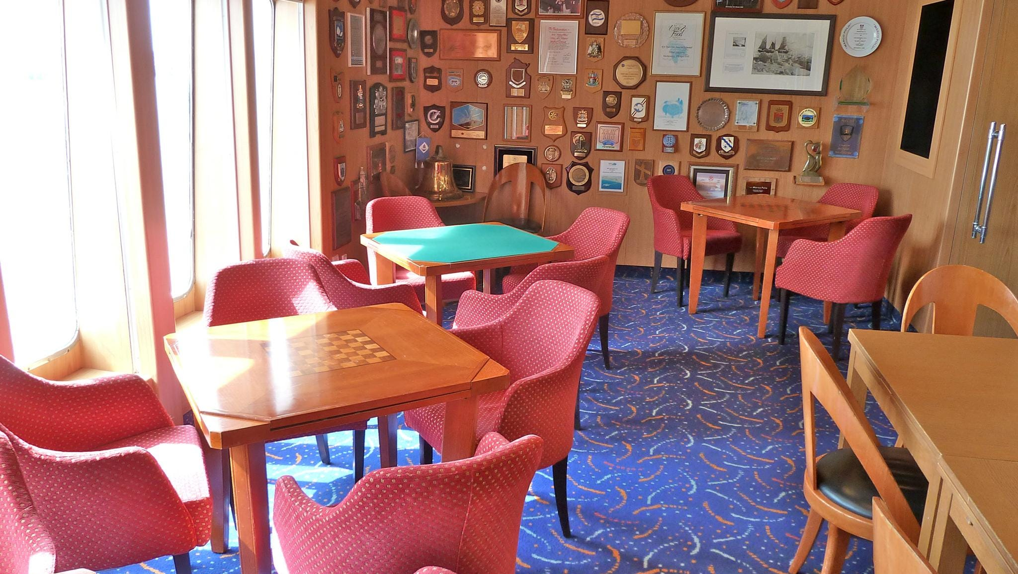 Stocked with board games, puzzles and cards, the Card Room is located on the port side of Magellan Deck.