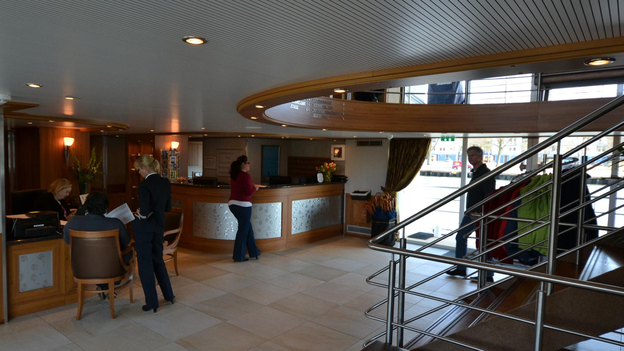 The ship's central lobby, where passengers will find the Hospitality Desk.