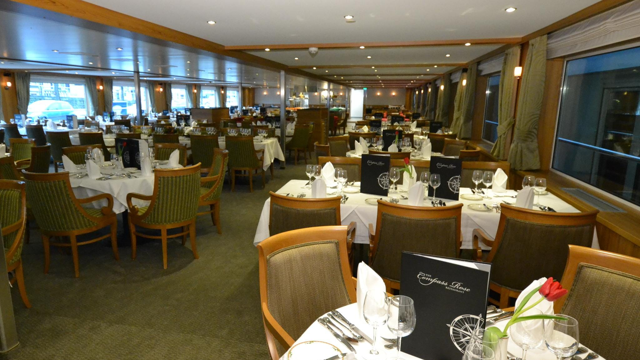 Serving breakfast, lunch and dinner, the main dining room, called the Compass Rose Restaurant, has capacity to seat every passenger on the ship at once.
