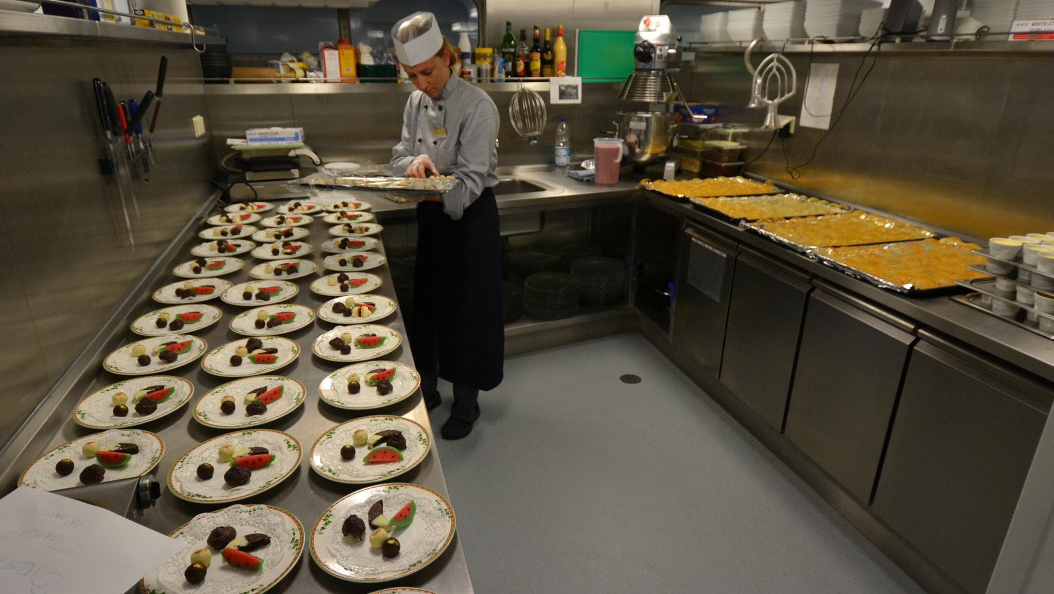 The ship's kitchen, located just below the main dining room, is where a small team prepares all of the food served on board.
