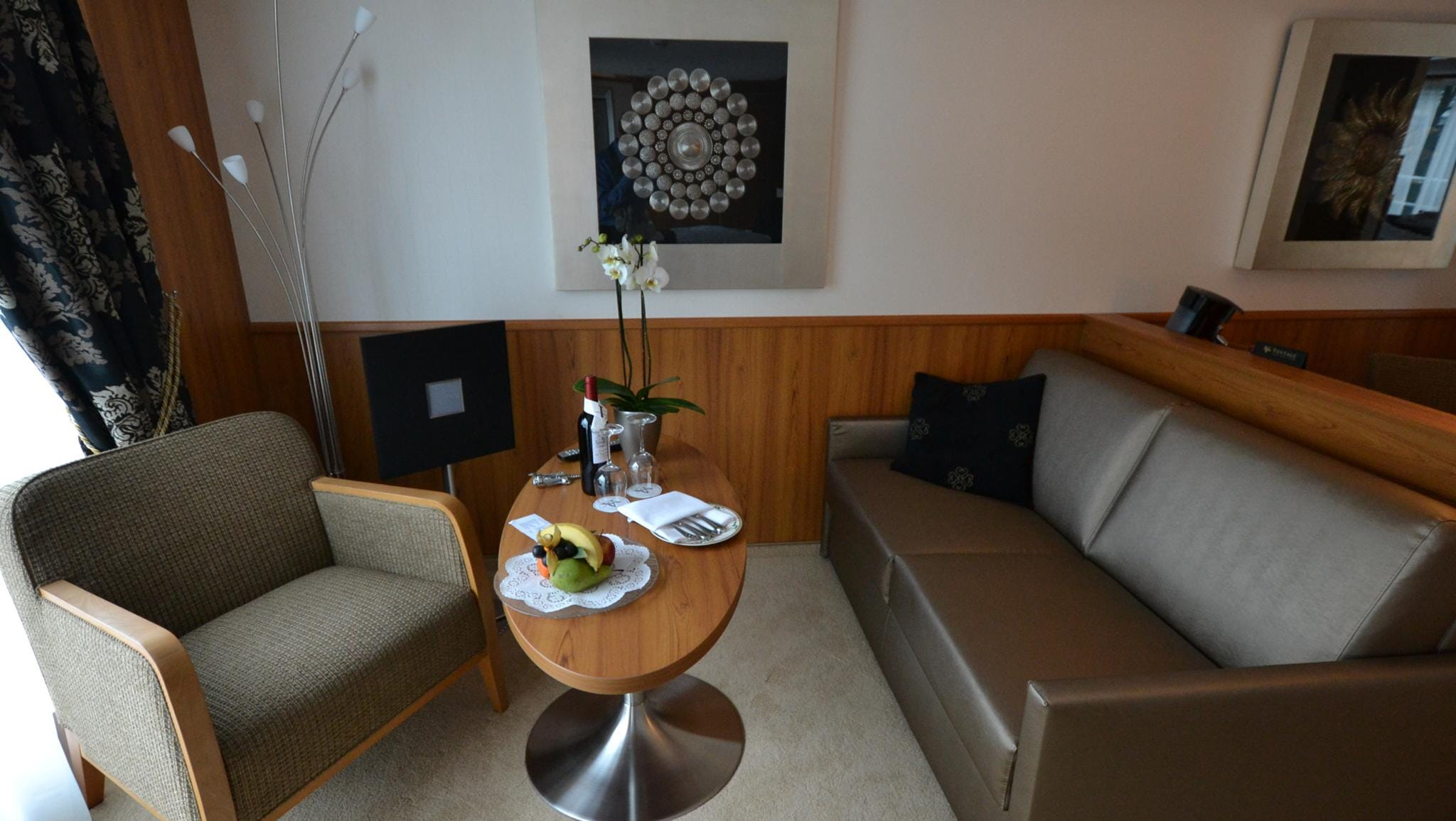 The sitting area in the Owner's Suite is larger than in a Deluxe Suite.