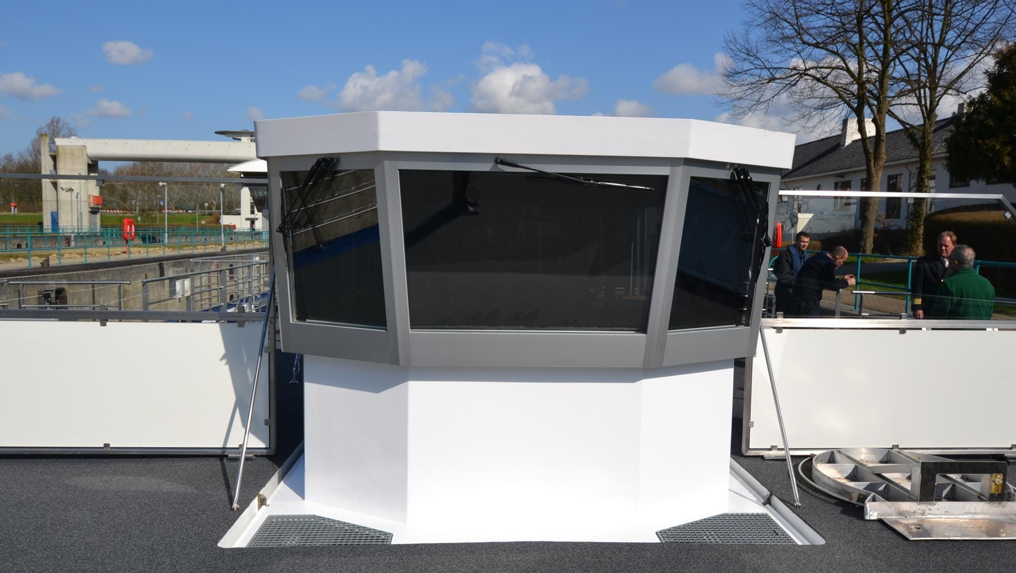 The River Discovery II's captain pilots the ship from a deck-top bridge that can be lowered hydraulically when the vessel passes under low bridges.
