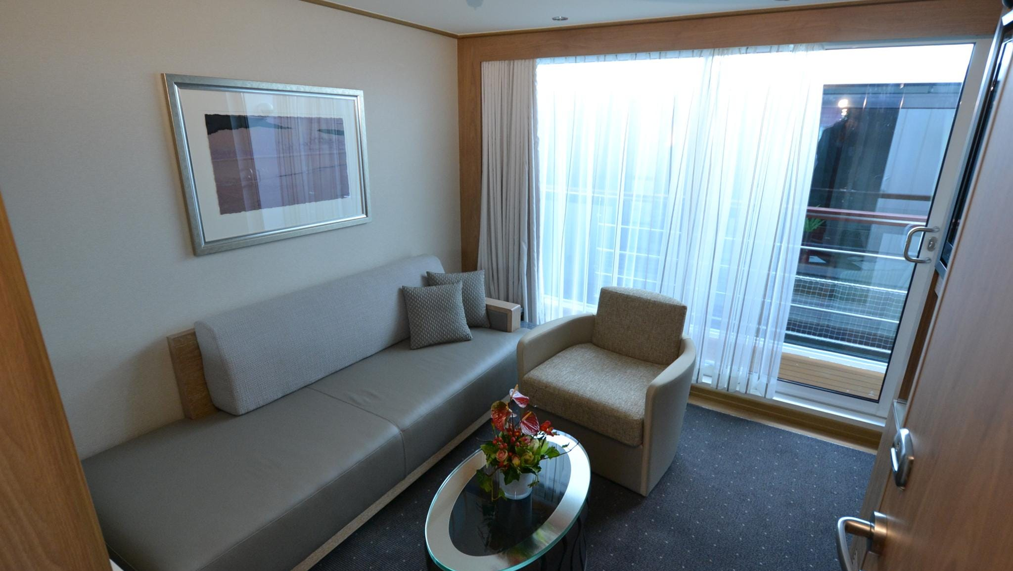 Veranda Suites feature a sitting room with wall-to-wall sliding glass doors overlooking a balcony as well as a connected bedroom.