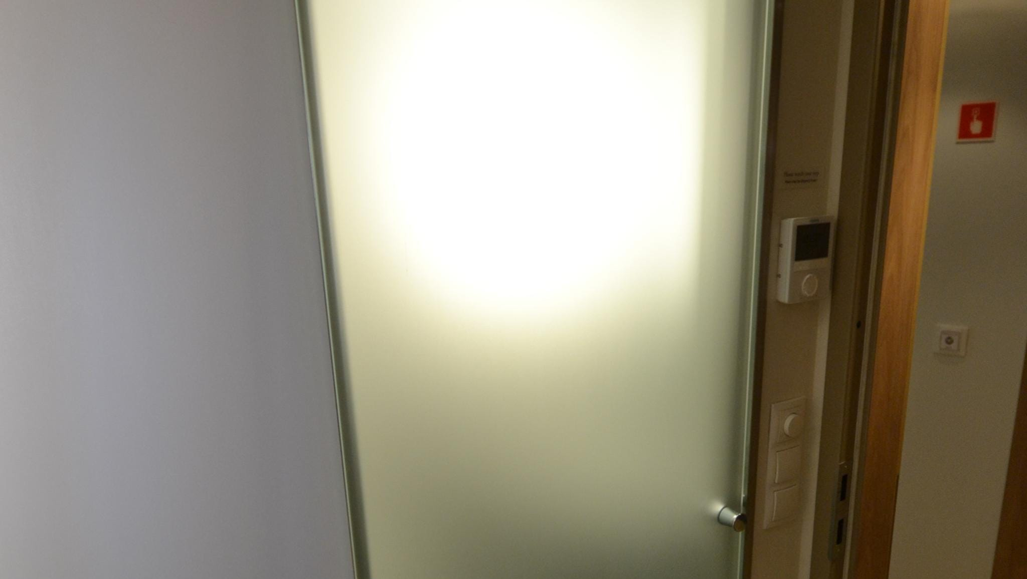 Bathrooms in Veranda Staterooms have translucent glass doors that slide shut.