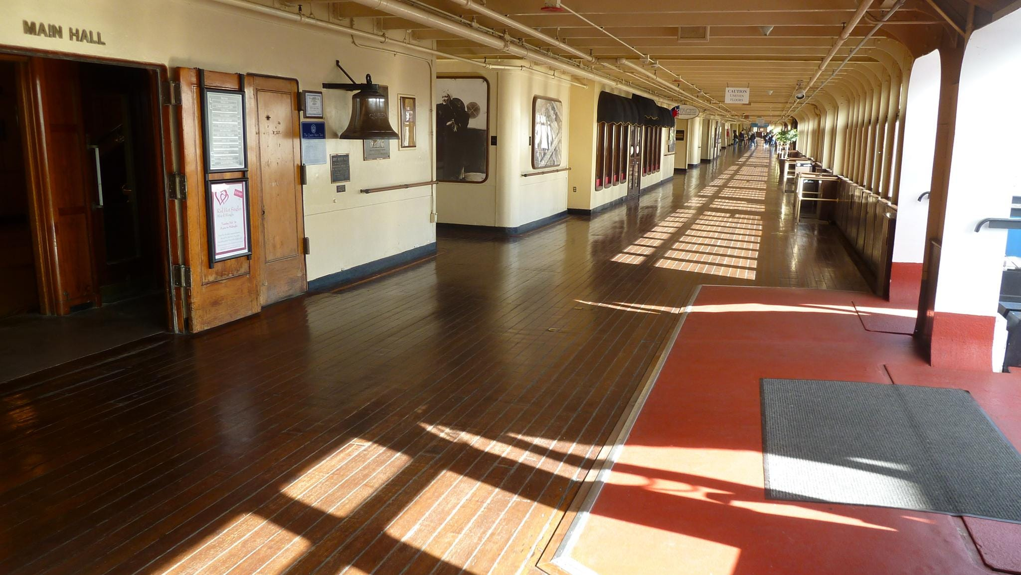 Visitors on tours of the Queen Mary take the elevators to level four and embark on the Promenade Deck's original teak-lined, glass-enclosed port promenade.