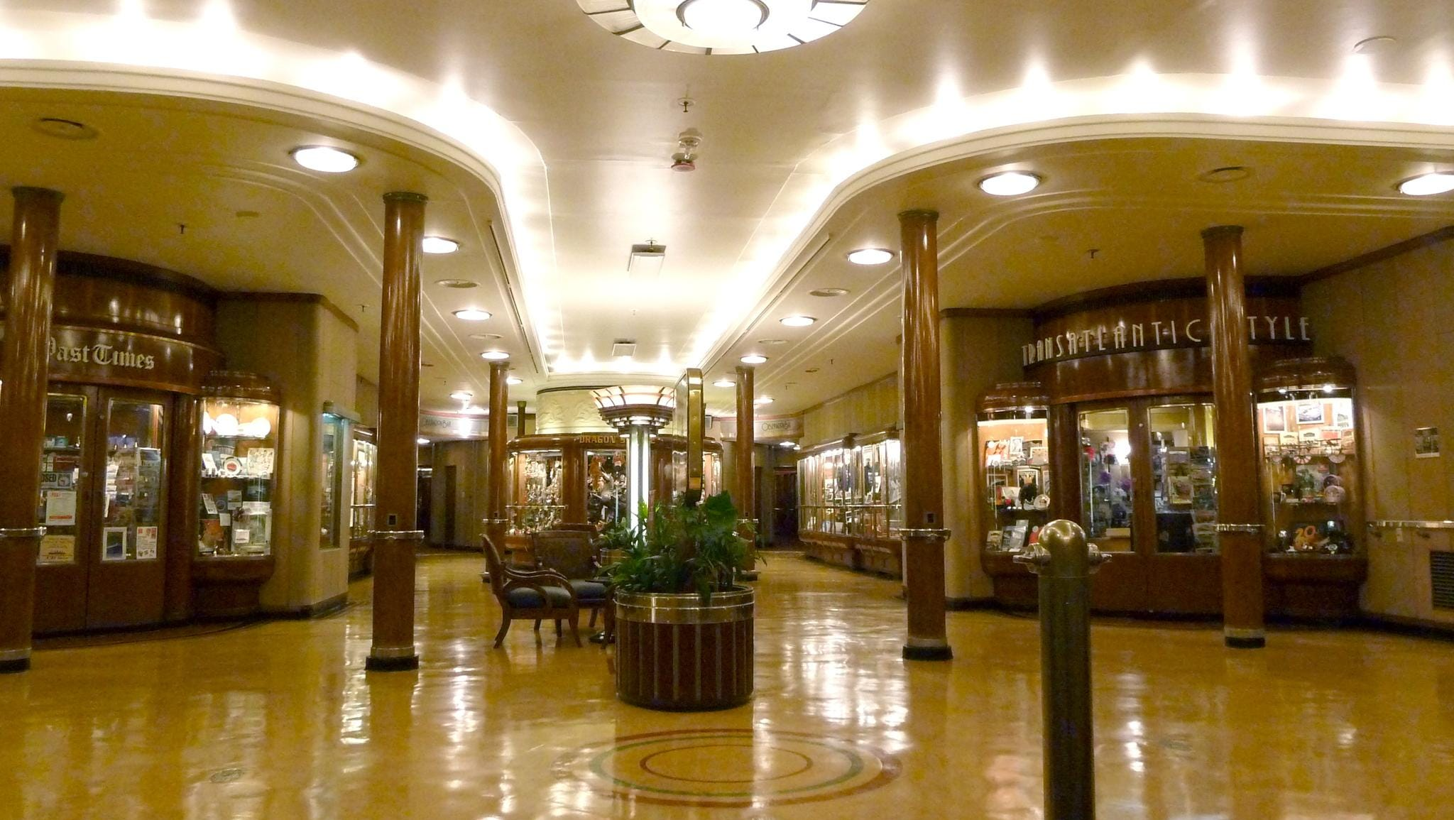 The Main Hall was the Queen Mary's first-class foyer and shopping arcade and features paneling in oaknut, chestnut and elm burr.