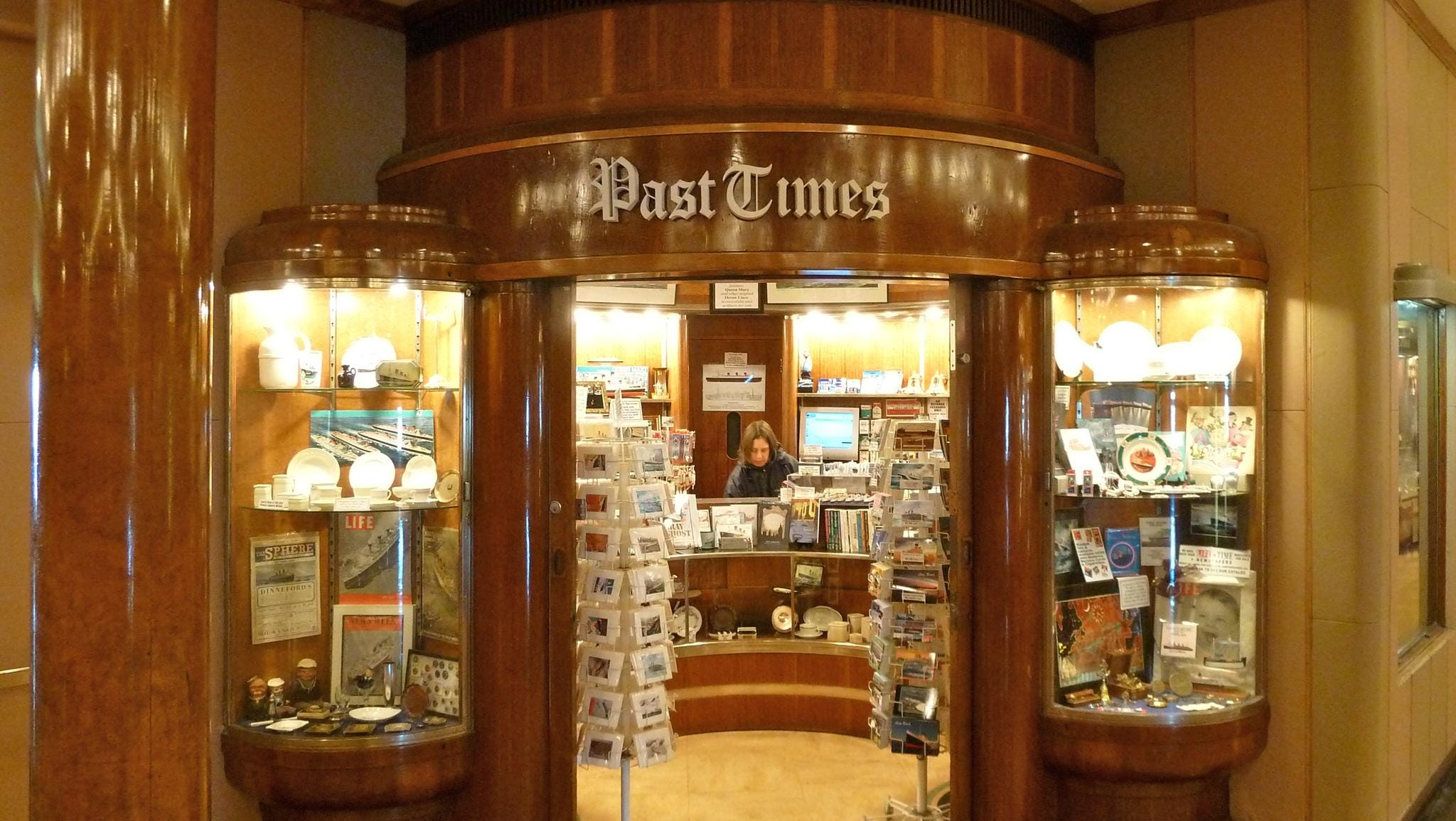PastTimes Collectibles is one of several boutiques in the Main Hall. Its specialty is vintage ocean liner ephemera.