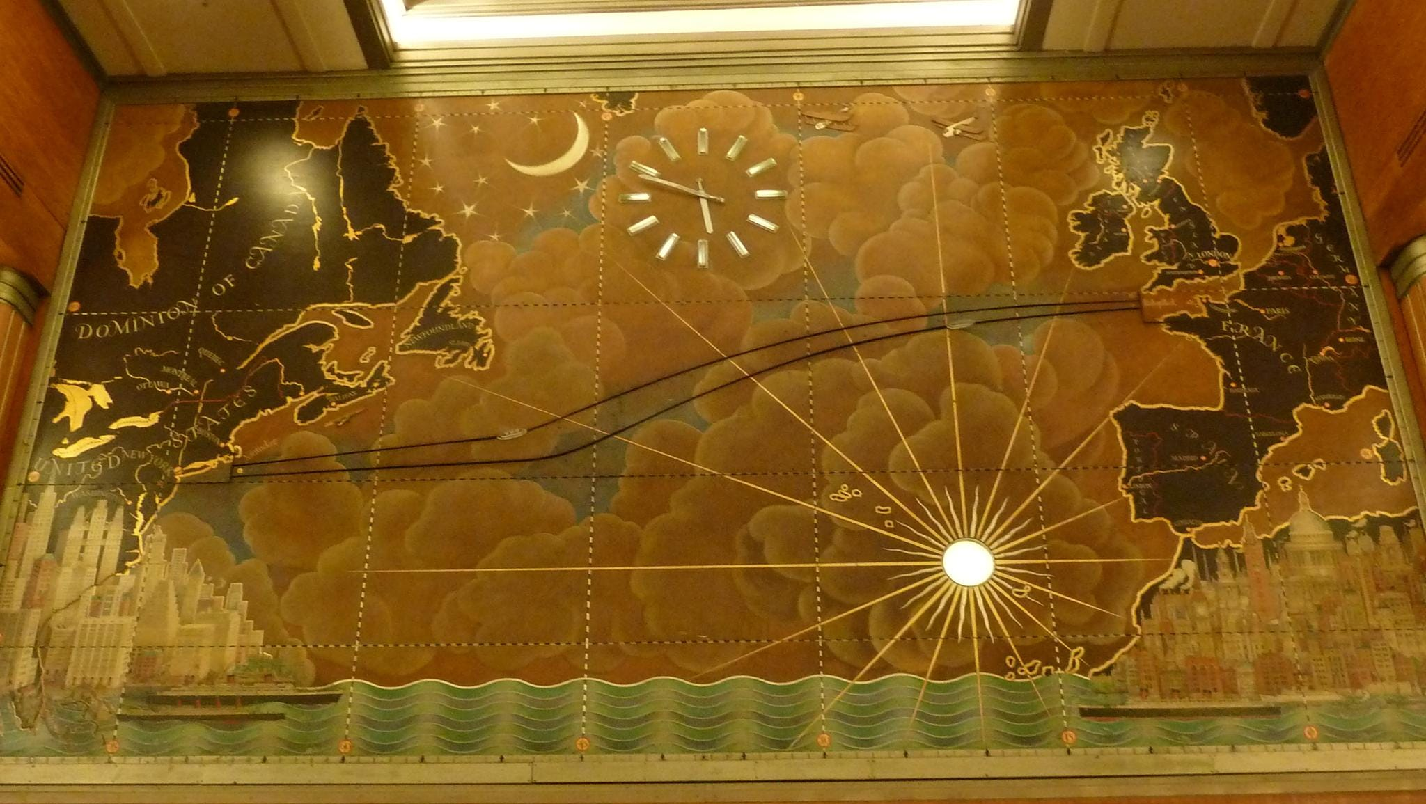 Macdonald Gill's famous trans-Atlantic mural on the forward bulkhead has been often imitated but never duplicated. Two crystal ships once traced the actual positions of the Queen Elizabeth and Queen Mary during their crossings.