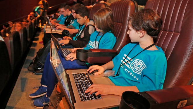 Starlord, in the dark sweatshirt, competed at the Minecraft Championships at the Cinema de Lux in White Plains on Saturday, Feb. 20, 2016.