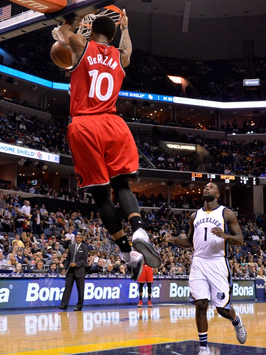 Toronto Raptors guard DeMar DeRozan (10) dunks the ball ahead of Memphis Grizzlies forward Lance Stephenson (1) in the first half of an NBA basketball game Friday, April 1, 2016, in Memphis, Tenn. (AP Photo/Brandon Dill)