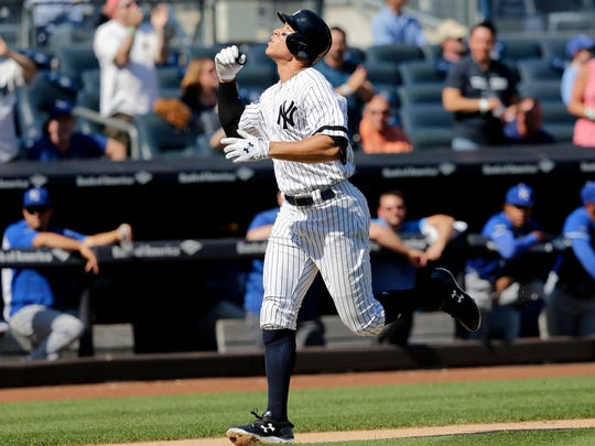\Yankees' Aaron Judge reacts as he runs the bases after