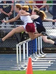 Milford's Sydney Phipps competes in the 110-meter hurdles.
