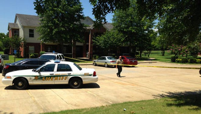 Shelby County deputies at crime scene where children were stabbed to death.