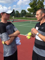 Plymouth assistant tennis coach Erik Batell (right)