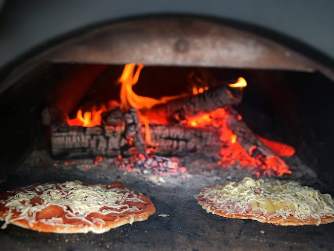 Mad Moose pizzas are cooked in a wood-fired oven built