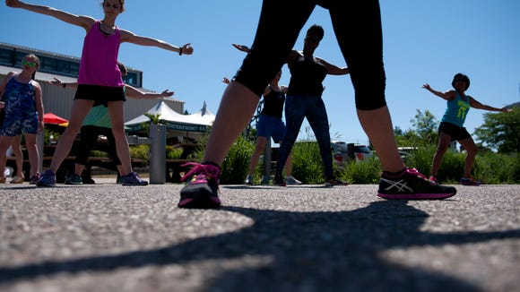 From left to right, Lansing residents Amber Smith, Kia Crawford and East Lansing resident Janet Kincaid dance during a free Zumba class from Spartan Dance Center on Saturday, June 25, 2016 at the Lansing City Market.