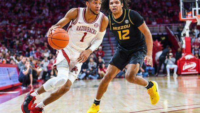 Razorback junior guard Isaiah Joe, left, drives to the basket against Missouri this past season at Bud Walton Arena in Fayetteville.
