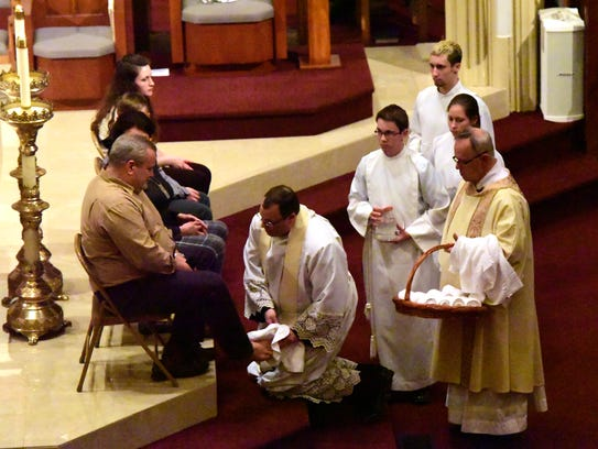 Rev. Michael Roemmele washes the feet of parishioners