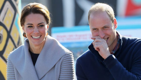 Kate glowed in a pale blue cardigan tie sweater by