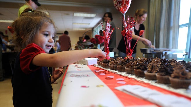 Annabelle Neese, 3, points out the cupcake she wants during the Chocolate Safari on Saturday, Feb. 11, 2017, at the Abilene Zoo.