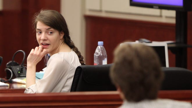 Shayna Hubers looks back at her mother, Sharon, during a break in the trial on Thursday.