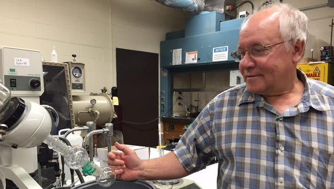 RIT associate professor Han Schmitthenner in his lab
