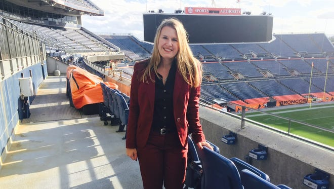 Jennifer attending a work event at Sports Authority Field this week
