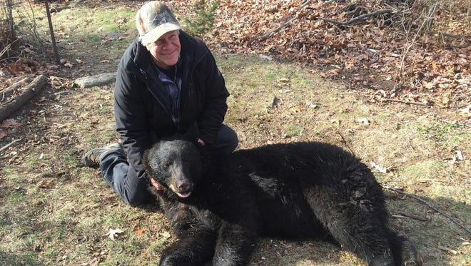 Brad Garie of Rockaway Twp., with a tranquilized  bear that destroyed his beehive and broke into his barn. The bear was released  because Garie didn't identify it as the destructive bear with 100-percent certainty.