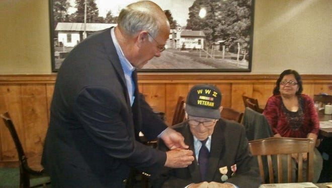 """Congressman Steve Pearce honored local World War II veteran William """"Bill"""" McTeigue with 6 medals for exemplary service Wednesday."""