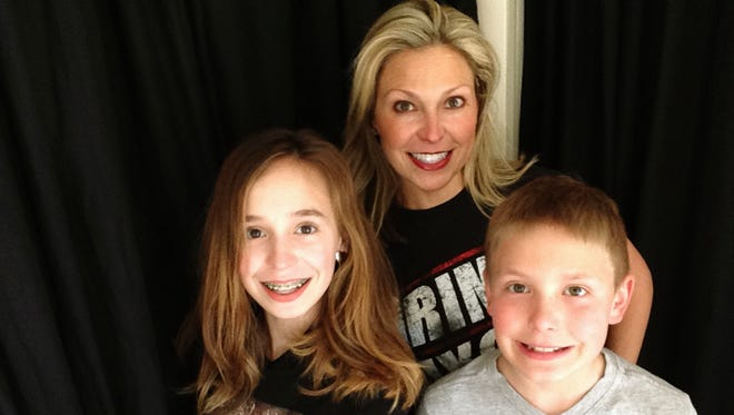 Ericka Calcagno, center, with her daughter Gina Binder, 12, left, and son Jean-Luc Binder, 9.