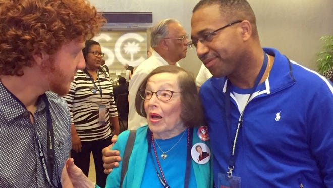 Felicia Kahn, a 90-year-old Democratic National Convention delegate from New Orleans, talks with Louisiana state Sen. Wesley Bishop (right) and Kahn's grandson, Zachary Kahn of Arlington, Va., on July 25, 2016 in Philadelphia.